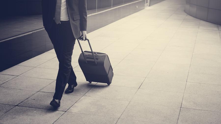 Businessman walk with Briefcase